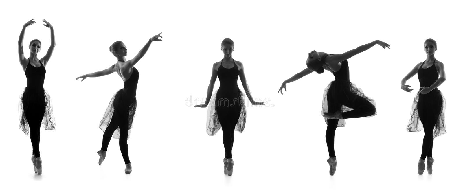 Young Caucasian ballet dancers in black dresses royalty free stock images