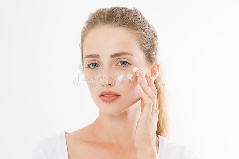 Young caucasian blonde woman and face skin care moisturizing cream on face. Anti aging and spa concept. Make up and nature beauty. stock photography