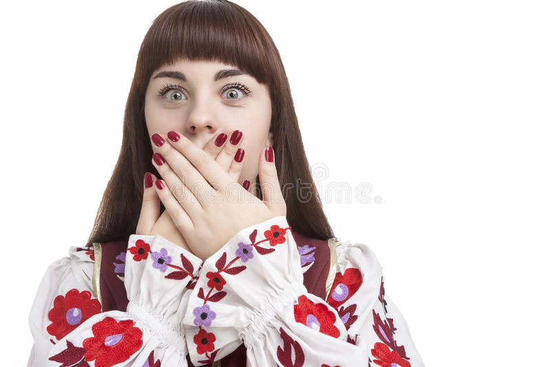 Young Caucasian Brunette Closing Her Mouth With Folded Palms. Frightened Facial Expression. Human Feelings and Emotions Concepts. Young Caucasian Brunette stock images