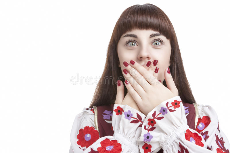 Young Caucasian Brunette Closing Her Mouth With Folded Palms. Human Feelings and Emotions Concepts. Young Caucasian Brunette Closing Her Mouth With Folded Palms royalty free stock image