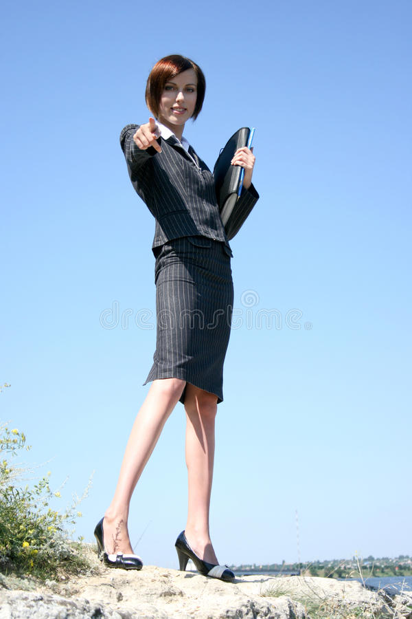 Young caucasian business lady with folders. Against blue sky royalty free stock photos