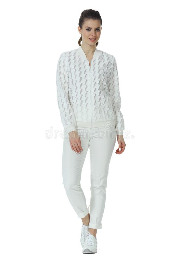 Young caucasian business woman executive posing in casual white clothes jacket and trousers high heels stiletto shoes royalty free stock photography