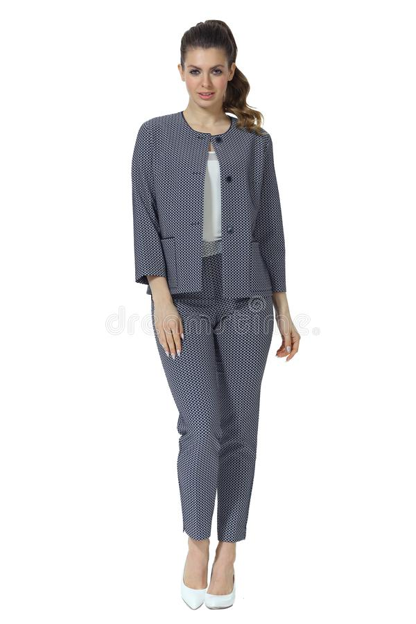 Young caucasian business woman executive posing in checked jacket jeans and sneakers shoes full body length royalty free stock photography