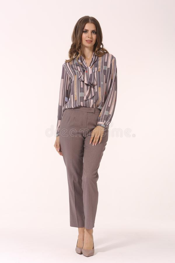 Young caucasian business woman executive posing in print blouse and trousers high heels stiletto shoes full body length isolated stock photos