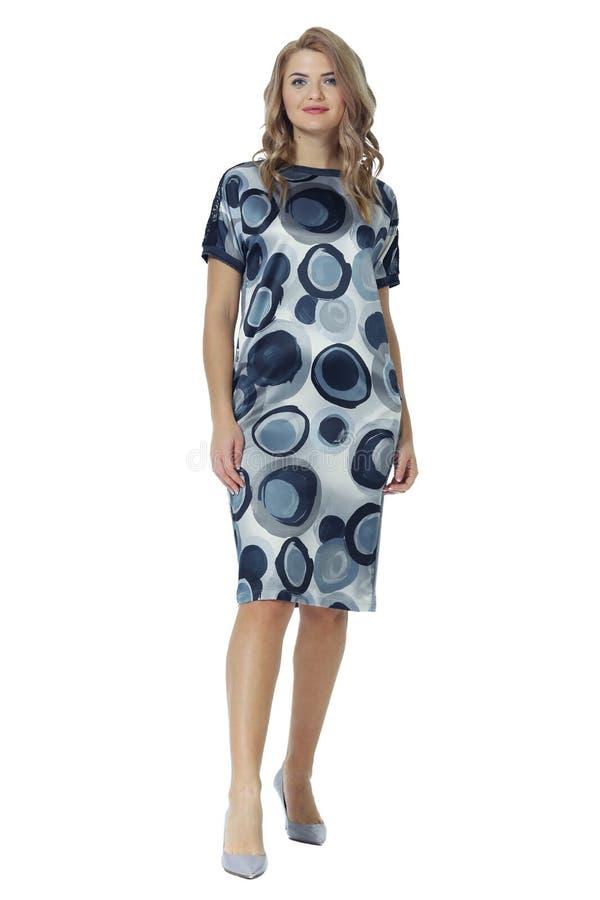 Young caucasian business woman executive posing in summer long print midi dress stock photography