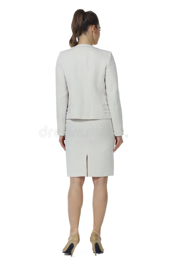 Young caucasian business woman executive posing in white official skirt suit high heels stiletto shoes royalty free stock image