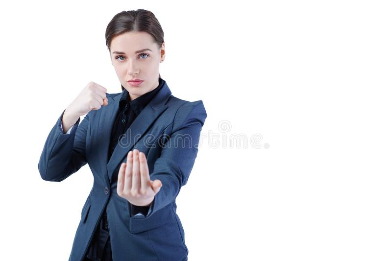 Young caucasian business woman in full length, ready for a fight isolated on white background. Young caucasian business woman in full length, ready for a fight royalty free stock images