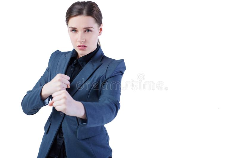 Young caucasian business woman in full length, ready for a fight isolated on white background. Young caucasian business woman in full length, ready for a fight stock photo