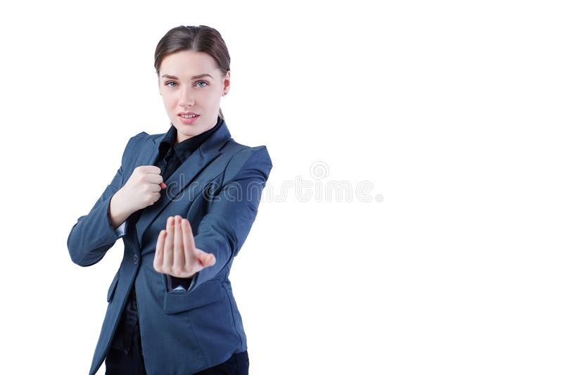 Young caucasian business woman in full length, ready for a fight isolated on white background. Young caucasian business woman in full length, ready for a fight stock photography
