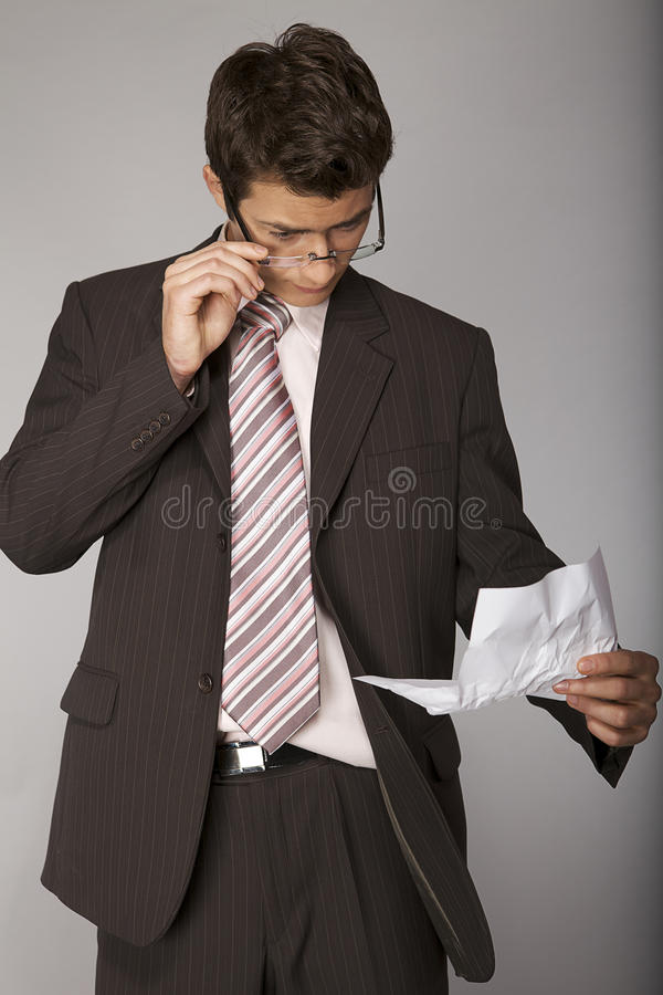 Young caucasian businessman stern on document royalty free stock images