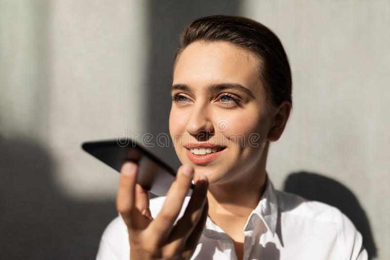 Young Caucasian businesswoman talking on mobile phone in office royalty free stock photo
