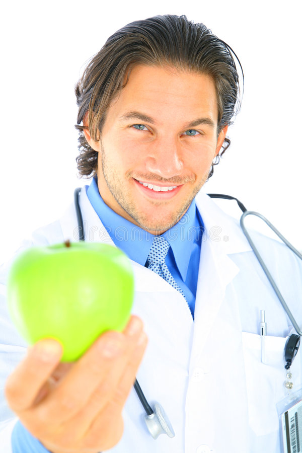Young Caucasian Doctor Offering Healthy Fruit Stock Image