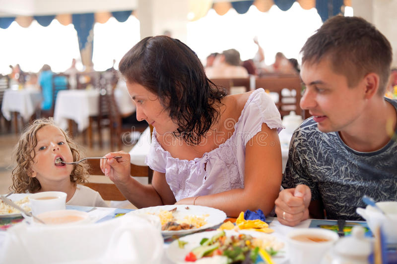 Young caucasian family having dinner together royalty free stock photography
