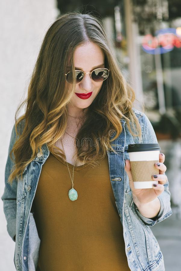 Young Caucasian Female Blogger with Coffee stock photo