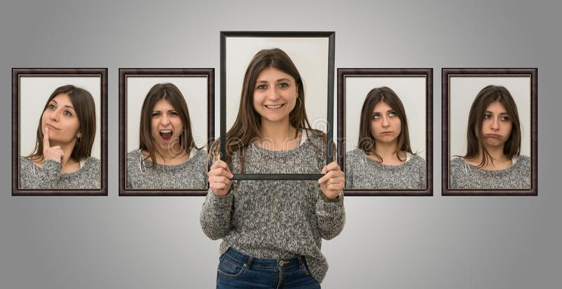 Young caucasian girl shows various facial expressions. Young caucasian girl isolated on grey background shows various facial expressions stock images