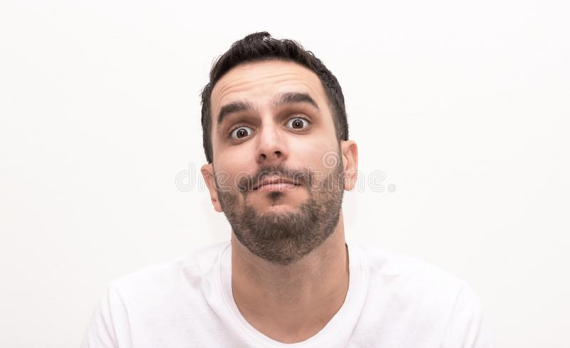 Caucasian young adult man looks surprised royalty free stock image