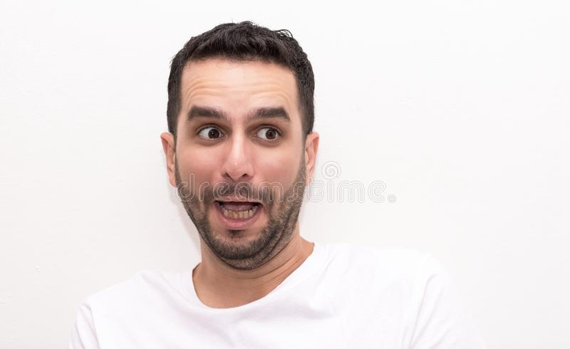 Caucasian young adult man looks surprised royalty free stock photos