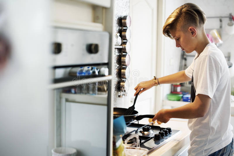 Young caucasian man cooking in the kitchen royalty free stock photo