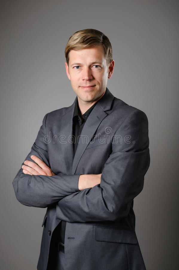 Young Caucasian Man Dressed Business Casual. A young Caucasian man looking confident in business casual clothing royalty free stock photo