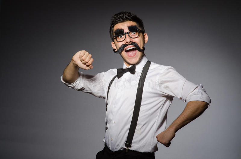 Young caucasian man with false moustache against stock photography