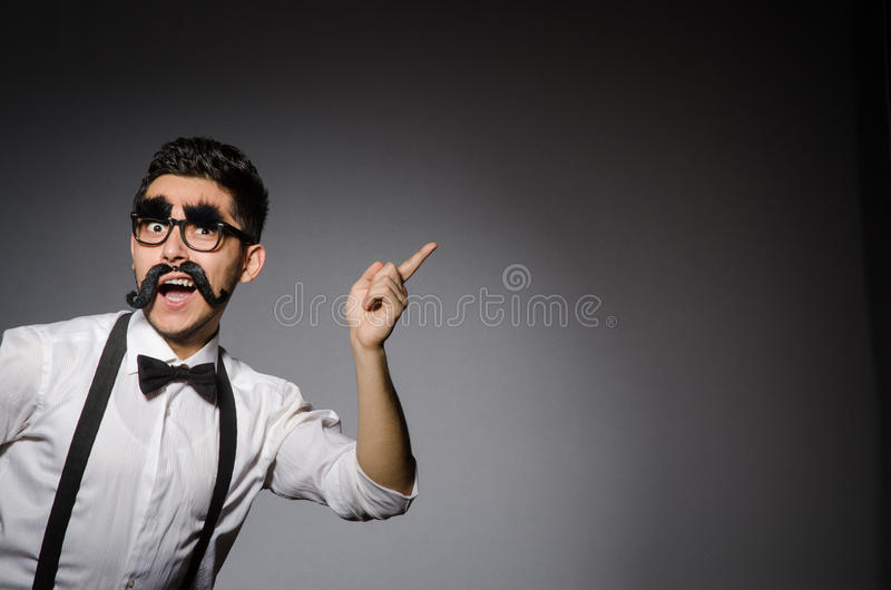 Young caucasian man with false moustache against royalty free stock images