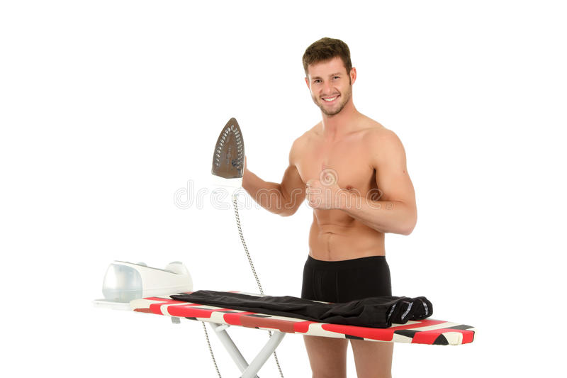 Young caucasian man ironing