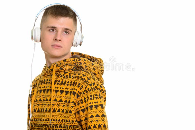 Young Caucasian man listening to music while thinking stock photo