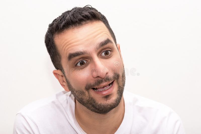 Young Caucasian man looks surprised, isolated royalty free stock photos