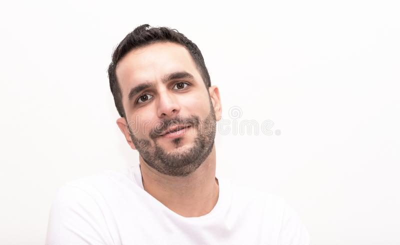 Young caucasian seems serious on camera stock photo