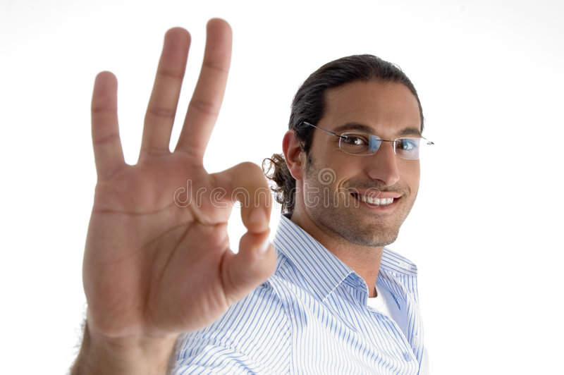 Young Caucasian Man With Ok Symbol Stock Images