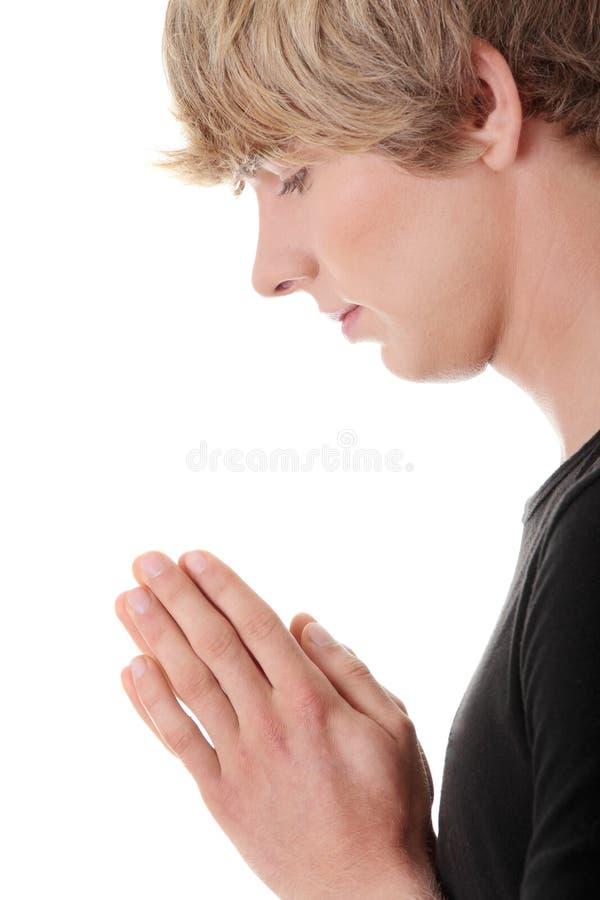Young Caucasian Man Praying Royalty Free Stock Images