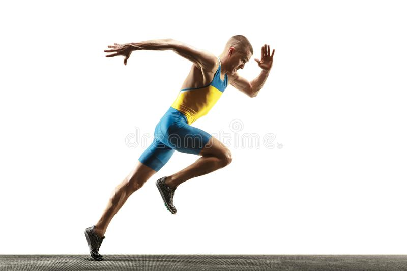 Young caucasian man running or jogging isolated on white studio background. stock photos