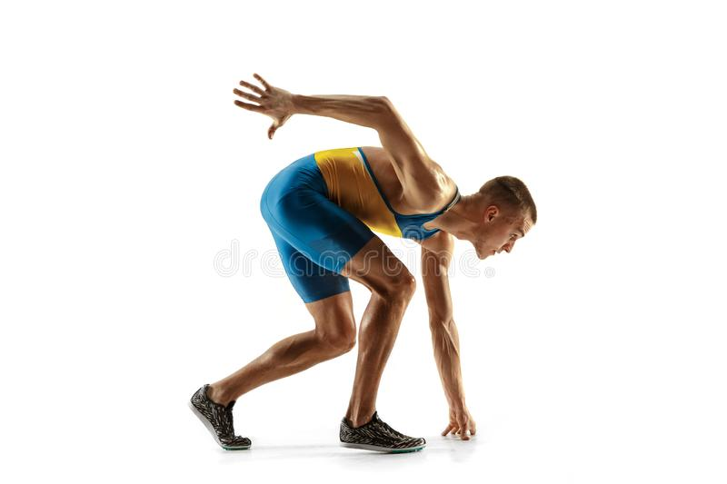 Young caucasian man running or jogging isolated on white studio background. stock image