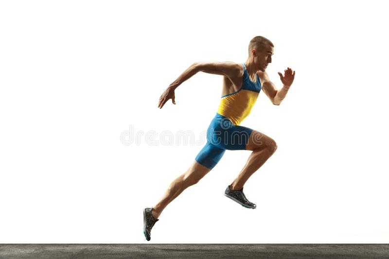 Young caucasian man running or jogging isolated on white studio background. stock photo