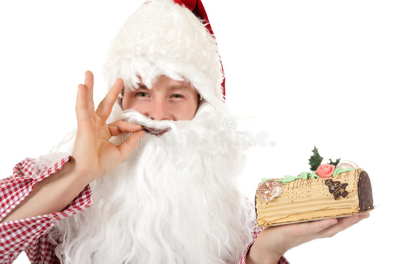 Young caucasian man Santa Claus, cake stock photos