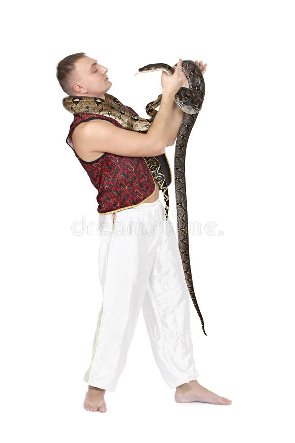 Young Caucasian man with snakes stock photo