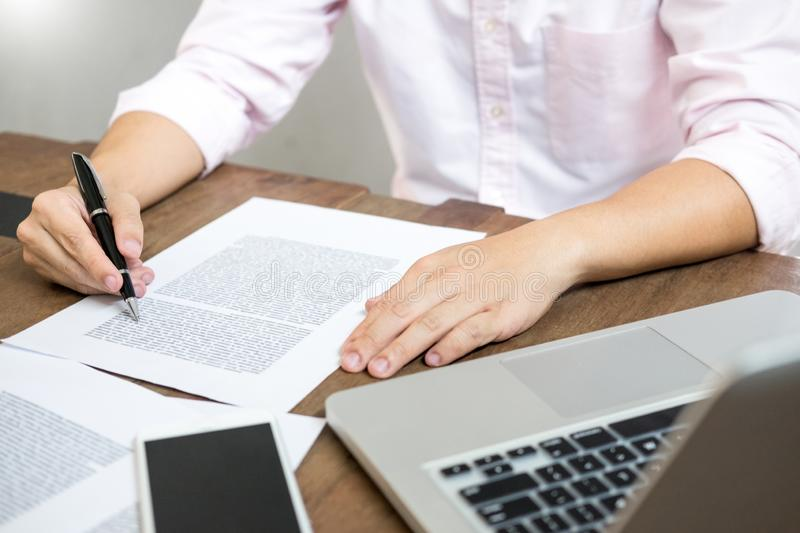 Young caucasian man working at home planning work writing note on some project with his laptop on a desk, strartup business, e. Learning concept royalty free stock images
