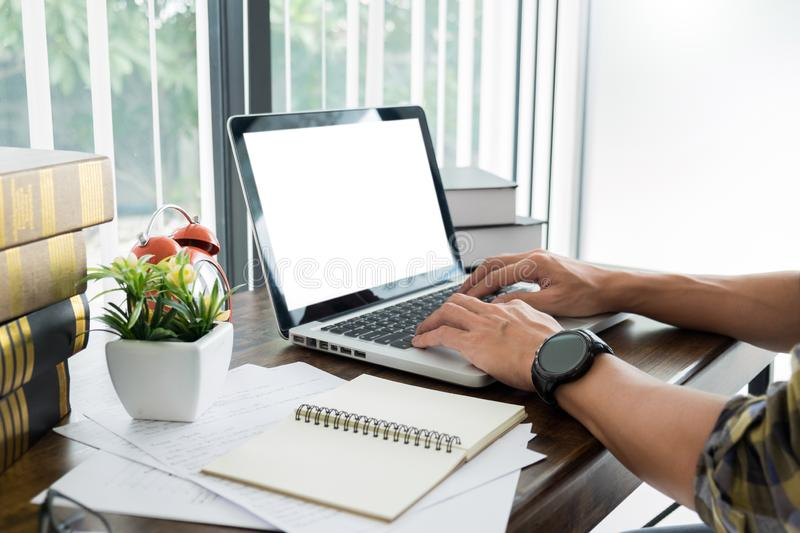 young caucasian man working at home planning work writing note on some project with his laptop on a desk, strartup business, e royalty free stock photos