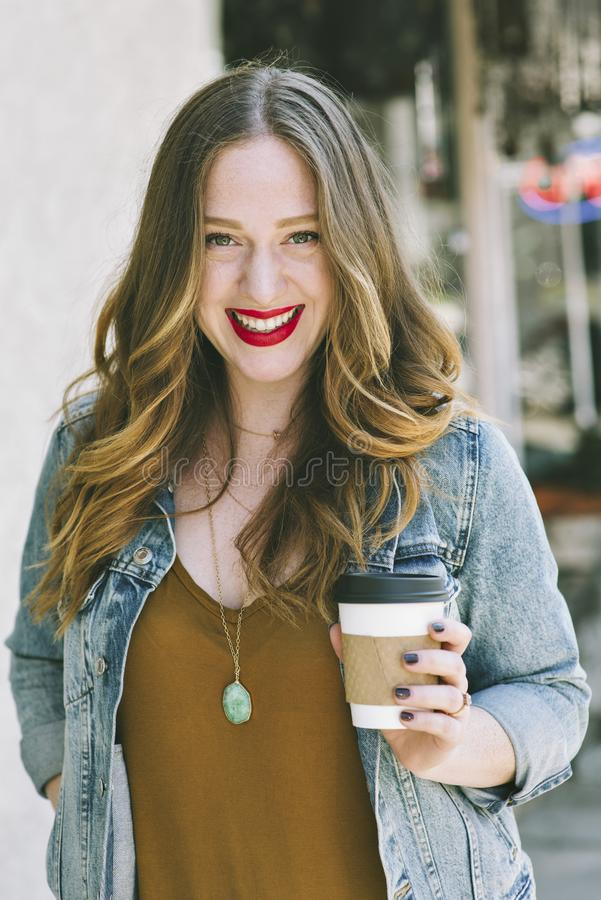 Young Caucasian Millennial Female with Coffee stock photography