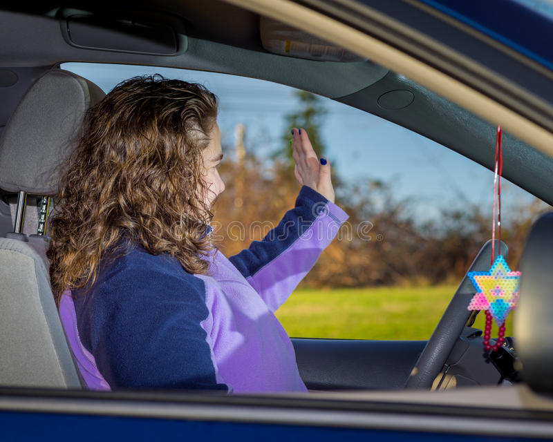 Young Caucasian Mom Waving Hand royalty free stock photography