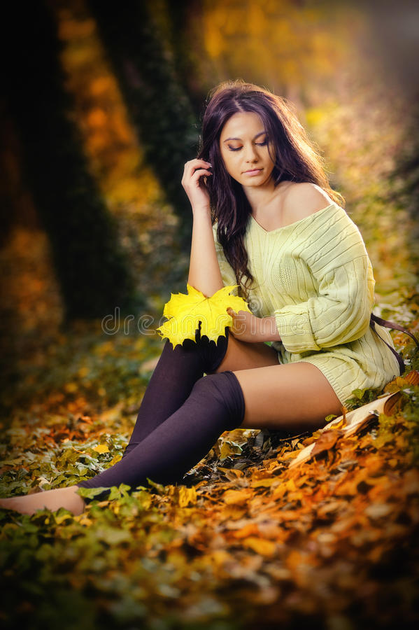 Young Caucasian sensual woman in a romantic autumn scenery. Fall lady .Fashion portrait of a beautiful young woman in forest royalty free stock photos