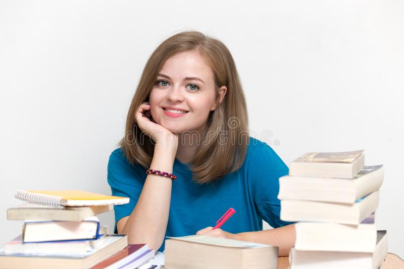 Young caucasian smiling girl woman with many books study at school or university stock photos