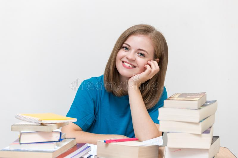 Young caucasian smiling girl woman with many books study at school or universityYoung caucasian smiling girl woman with many books royalty free stock photos