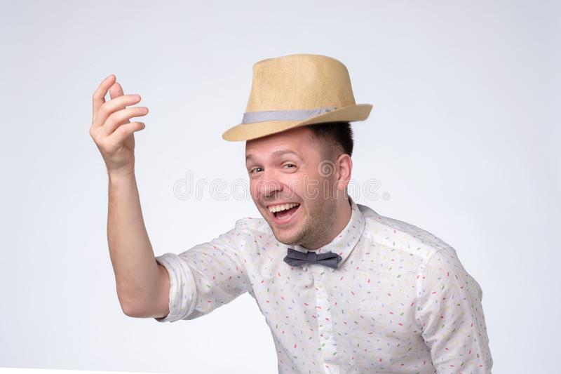 Young caucasian tourist man wearing hat ready for vacation stock photos
