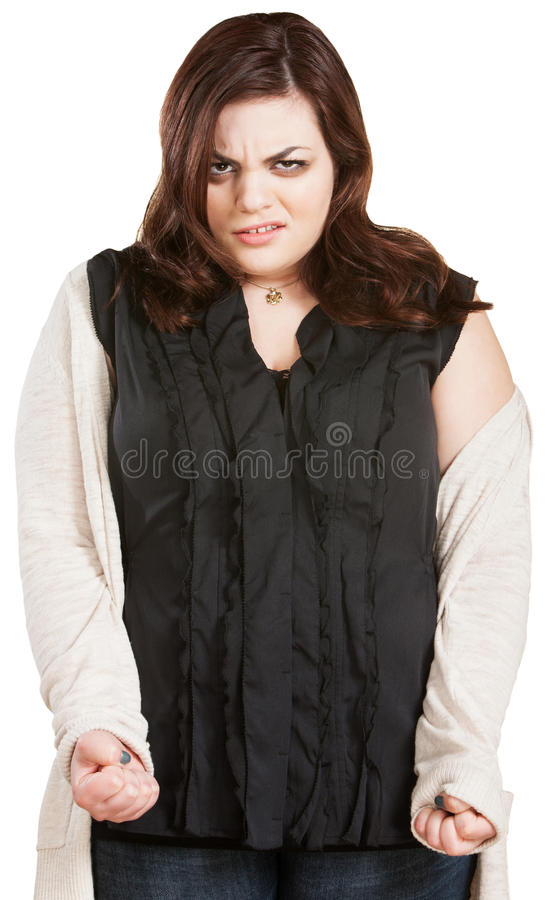 Woman with Clenched Fists. Young Caucasian woman with clenched fists over isolated background stock images