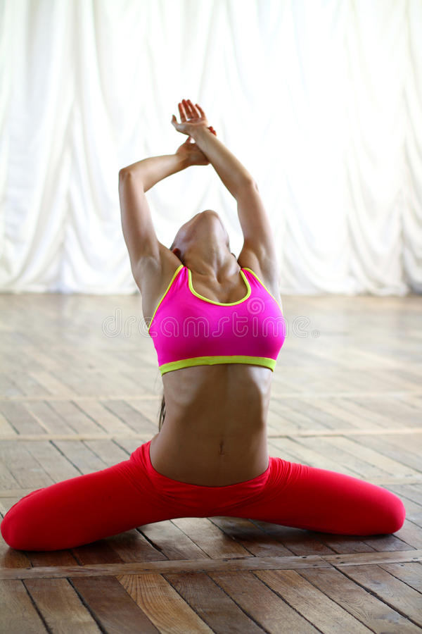 Young caucasian woman dancer in pink clothes. Young caucasian woman dancer is posing stock images
