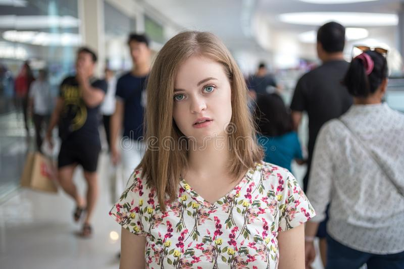 Young caucasian woman girl stand out from the crowd alone. Loneliness concept royalty free stock photos
