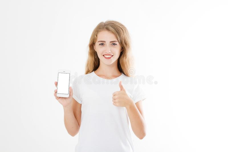 Young caucasian woman, girl in t-shirt holding blank screen mobile phone showing one or like count isolated on white background stock image