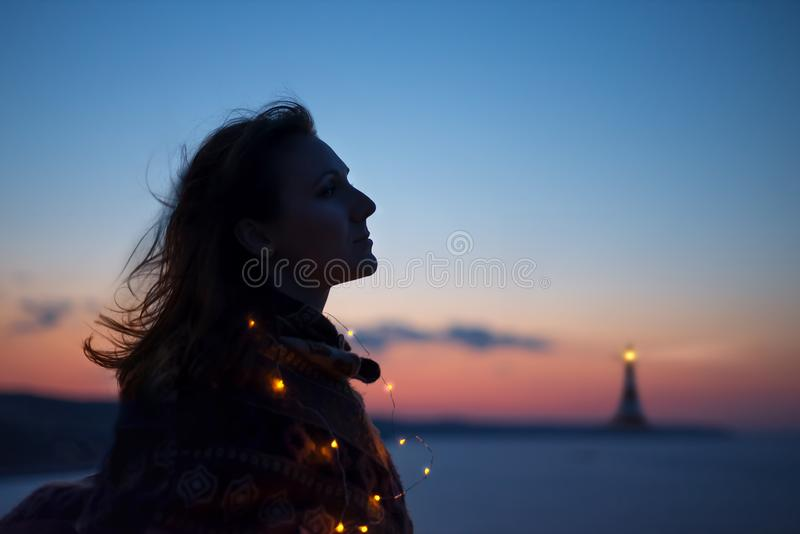 Young caucasian woman with lighthouse royalty free stock image