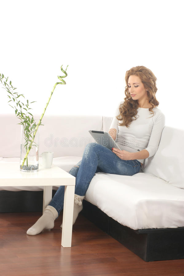 Download A Young Caucasian Woman In A Modern Interior Royalty Free Stock Photo - Image: 25240535